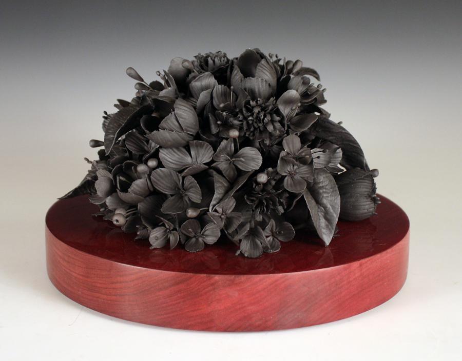 "Rain Harris, ""Tumulous"" 2014, black clay, nichrome wire, resin, African purple heart wood, 11.5 x 11.5 x 9""."
