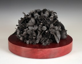 "Rain Harris, ""Tumulous"" 2014, black clay, nichrome wire, resin, African purple heart wood, 11.5 x 11.5 x 9""."