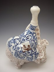 "Sin-ying Ho, ""Hero No. 1"" 2008, porcelain, cobalt, decal, terra sigillata, 15.5 x 11.25 x 8.5""."