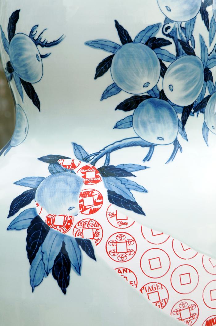 "Sin-ying Ho, ""Temptation - Life of Goods No. 2"" 2010, porcelain, cobalt pigment, underglaze, decal, glaze, 68 x 23.5""."