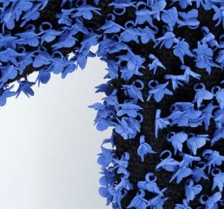 "Caroline Cheng, ""Prosperity V"" detail, 2007, porcelain, fabric, 71 x 71""."
