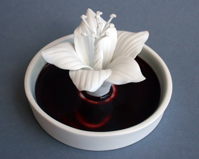 "Julie Bartholomew, ""Rarely Seen, Phillip Island Hibiscus"" 2013, porcelain, copper red glaze, decals, 2.75 x 3.5""."