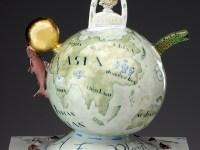 "Mara Superior, ""Smart Planet: Homage to Science"" detail, 2009, porcelain, glaze, wood, gold leaf, tin pencil sharpener (feet), 21 x 17 x 11""."