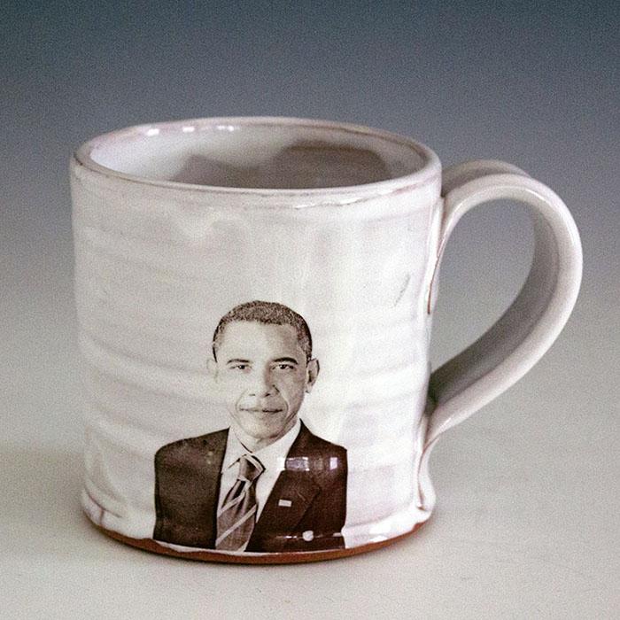 "Justin Rothshank, ""Barack Obama Mug"" 2016, earthenware, glaze, ceramic decals, 4 x 3.5""."