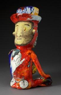 "Micheal Lucero, ""Pre-Columbian Man with George Ohr Pot"" 1991, ceramic, glaze, 17 x 11"". (Pennington)"
