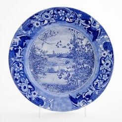 """Paul Scott, """"Scott's Cumbrian Blue(s), New American Scenery, Albany, New York, 2019, in-glaze screen print (decal) on salvaged Syracuse China with pearlware glaze, 11 x 11 x 1""""."""