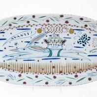 "Mara Superior, ""Vivere/Rabbit"", 2020, porcelain, ceramic oxides, underglaze, glaze, gold luster, 10 x 20.5 x 1.5""."