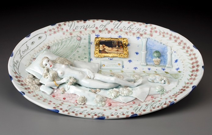 "Mara Superior, ""Venus of Urbino"" 2018, porcelain, underglazes, oxides, glaze, gold leaf, decal, 13 x 19 x 3""."
