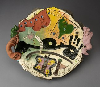 "Don Reitz, ""Do You Think I Would Forget?"", 1987, hand-built black earthenware with colored engobes and glaze, 23 x 23""."