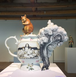 "Kadri Pärnamets, ""Steam from Tea or (Tea Steam) tribute to Alice in Wonderland"" 2016, porcelain, slip, glaze, decals, 17.5 x 6 x 15.25""."