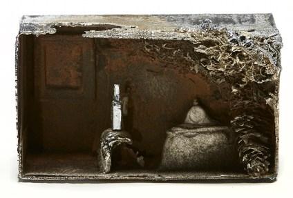 "Beth Lipman, ""Distill #7"" 2016, cast iron with rust patina, chrome, 8 x 12 x 5"". Photo courtesy of John Michael Kohler Arts Center/ Kohler Co."
