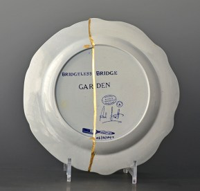 "Paul Scott, ""Cumbrian Blue(s), The Garden Series, Bridge/Bridgeless"" (back), 2019, collage with kintsugi, 'St Alban's Abbey' by Henshall with 'Chinoisserie Bridgeless' by Minton, (early 19th century transferwares), 10"" diameter."