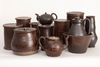 """Linda Sikora, 'Faux Wood Group'. 2014-2018, stoneware, polychrome glaze, group footprint 12"""" x 3' x 2', Individual works: 5""""-12"""" in height."""