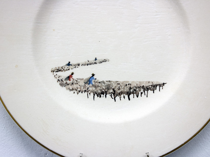 "Hollie Lyko, ""American Standard"", detail, 2018, dremel-erased Syracuse China plate, originally titled 'Southern Cotton Fields', circa 1952, 10.5 x 10.5 x 1""."