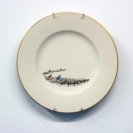 "Hollie Lyko, ""American Standard"", 2018, dremel-erased Syracuse China plate, originally titled 'Southern Cotton Fields', circa 1952, 10.5 x 10.5 x 1""."