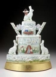 "Mara Superior, A Spring Dream (Rabbit Teapot),2008, high-fired porcelain, ceramic Oxides, Underglaze, glaze, wood, gold leaf, 16 x 17 x 6"". Gift of Kohler Foundation."