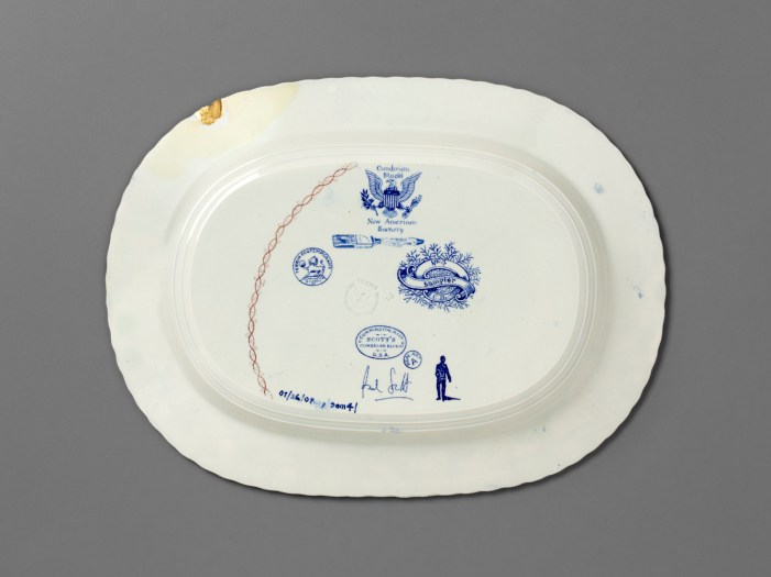 "Paul Scott, ""Scott's Cumbrian Blue(s), New American Scenery, Pattern Sampler No: 4 (Adams)"" back, 2019, in-glaze decal collage on shell-edge, pearlware platter c.1820, 10 x 13 x 1.5""."