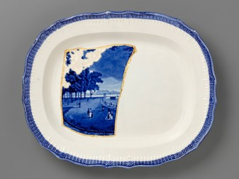 "Paul Scott, ""Scott's Cumbrian Blue(s), New American Scenery, Castle Garden Battery, New York, after Enoch Wood (triptych)"" 2019, Collage, Fragmented Enoch Wood transferware (c.1840) and gold leaf, set in Leeds Pottery shell-edged pearlware platter (c.1840), with kintsugi, 14 x 17 x 1.75""."