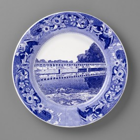 "Paul Scott, ""Scott's Cumbrian Blue(s), New American Scenery, Belle Island Bridge, Detroit"" 2019, in-glaze screen print (decal) on salvaged Syracuse China with pearlware glaze, 11 x 11 x 1""."