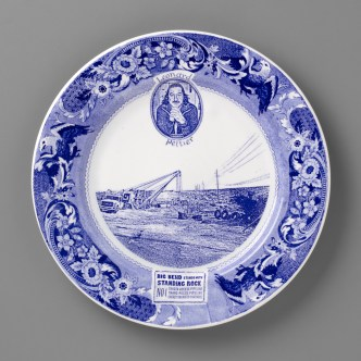 "Paul Scott, ""Scott's Cumbrian Blue(s), New American Scenery, Pipelines & Peltier"", 2019, in-glaze screen print (decal) on salvaged Syracuse China with pearlware glaze, 11 x 11 x 1""."