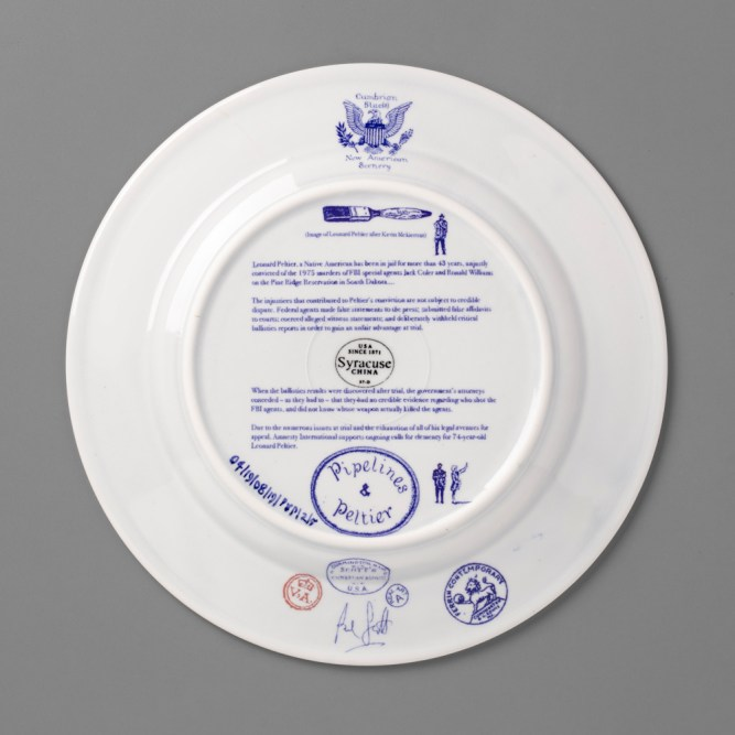 "Paul Scott, ""Scott's Cumbrian Blue(s), New American Scenery, Pipelines & Peltier"", back, 2019, in-glaze screen print (decal) on salvaged Syracuse China with pearlware glaze, 11 x 11 x 1""."