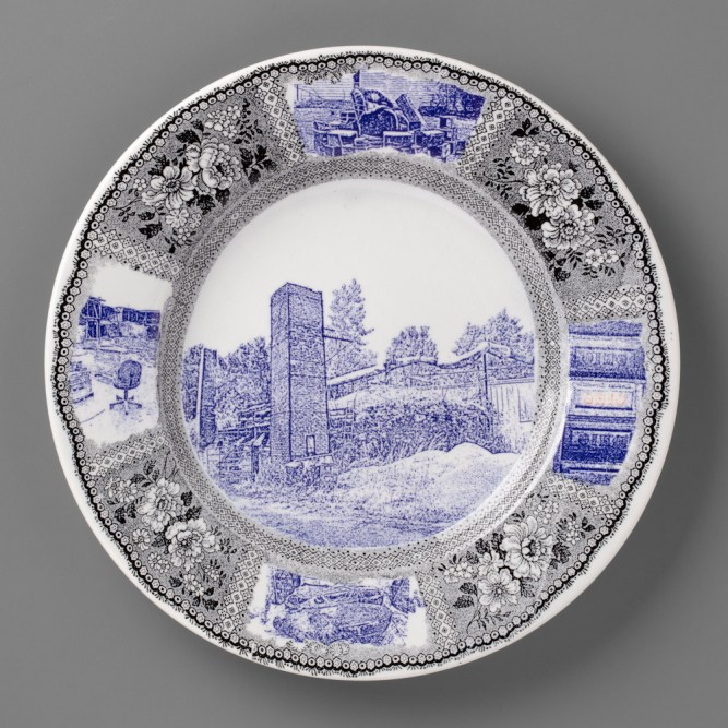 "Paul Scott, ""Scott's Cumbrian Blue(s), New American Scenery, Ohio"" 2019, in-glaze screen print (decal) on salvaged Syracuse China with pearlware glaze, 12 x 12 x 1.25""."