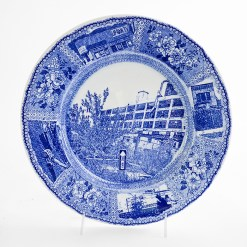 """Paul Scott, """"Scott's Cumbrian Blue(s), New American Scenery, Detroit Ghost Gardens #2"""", 2019, in-glaze screen print (decal) on salvaged Syracuse China with pearlware glaze, 12 x 12 x 1.25""""."""