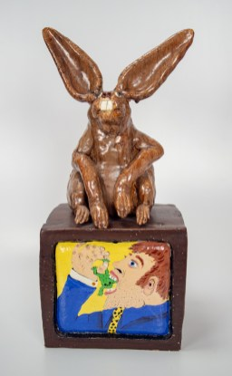 "David Gilhooly, ""Chicago art critic forced to swallow a frog"", 1977, clay, 23.5 x 10 x 10.5""."