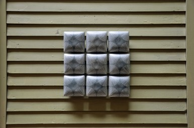 "Giselle Hicks, ""Grey Tiles with Radial Pattern"", 2019, slip-cast porcelain, 15 x 15 x 2.5""."