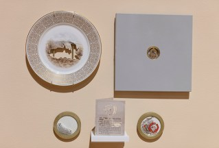 "Elizabeth Alexander, 'The Great Enemy of Truth' , detail, 2019, Hand cut set of Confederate commemorative porcelain plates, paper packaging, glass, wood, brass wall mounts, 60 x 260 x 5""."