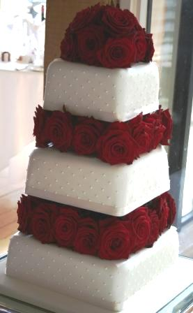 Melanie Ferris Cakes News      Wedding Cakes with Red Roses and Dots 20110128 Dots and red roses between tiers JPG