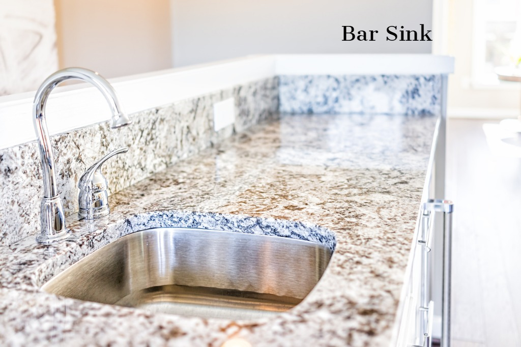 bar sink so that someone can help with cooking or serving when entertaining