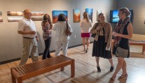 Attendees take advantage of the Art Gallery during the social hour. From Ferris SmugMug gallery http://ferrisphotos.smugmug.com/Academic/Honors/2015-40-Dinner/