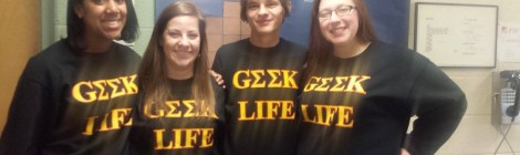 Honors Students Smiling in Geek Life Apparel. Courtesy of the photographer with permission from Honors student, Jordan Dawkins