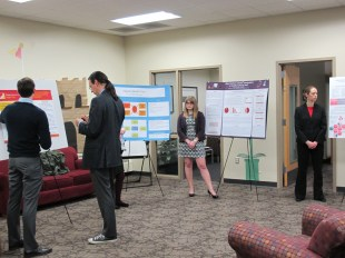 Dr. Peter Bradley scores the symposium projects. Courtesy of the photographer.