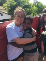 Cindy Tran with child in Dominican Republic. Courtesy of Honors Student, Cindy Tran.