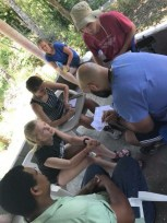 Madeline Keely talks with doctor in Dominican Republic. Courtesy of honors student, Madeline Keely.