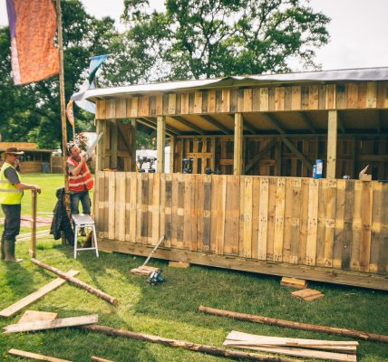 Men at work  Sound booth building in the main arena