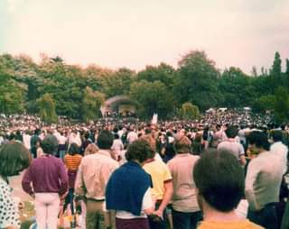 May be an image of one or more people, people standing and outdoors