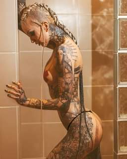 May be an image of 1 person, tattoo and indoor