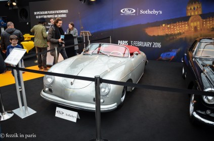 An old Porsche, which resembles a fat, flat dick.