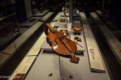 An intricately-carved instrument.