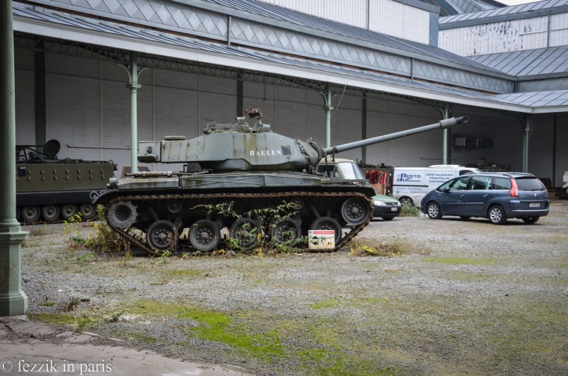 A tank, a minivan, and a catering truck roll into a museum...