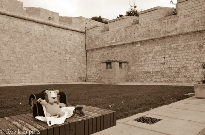 Marco in the Mdina moat. he has no comment on his history with the prison-resembling structure to the right.