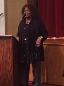 "Rev. Yvonne Moore-Fant performs Shalom Aleiche--Peace to All"" during Interfaith Service"