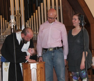 Pastor Robbie baptizing Ishmael