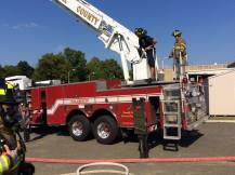 photo of firefighters on ladder truck