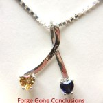 Citrine and Sapphire Ribbon Necklace - shows 2 stones set on a ribbon made out of sterling silver.