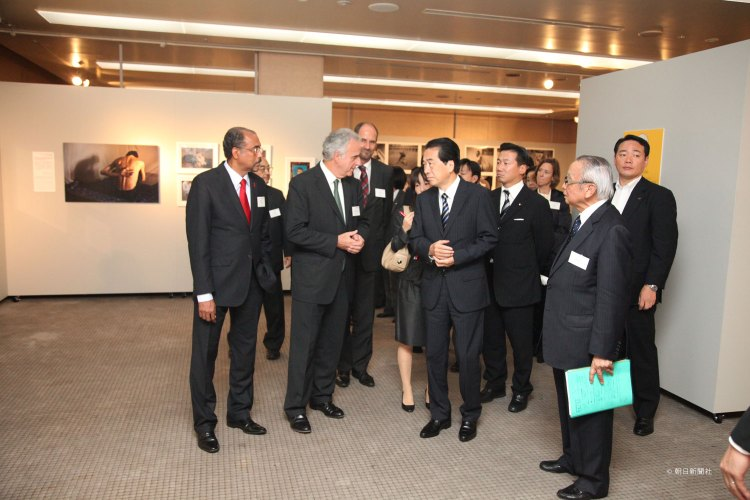 Then Prime Minister Naoto Kan visits the September 2010 opening of a photo exhibit depicting people living with HIV/AIDS