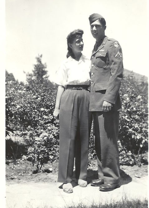 1940s fashion - woman in pants and man in uniform
